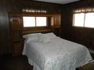 Main bedroom  with Queen bed at Snowman Cabin.