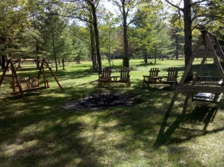Campfire firepit area of Wilderness Pines vacation home.